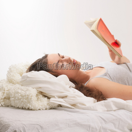 woman reclined with reading book