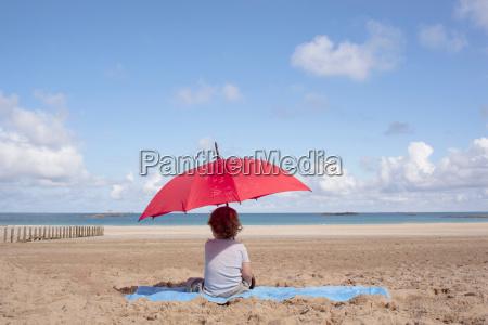 young boy under a parasol