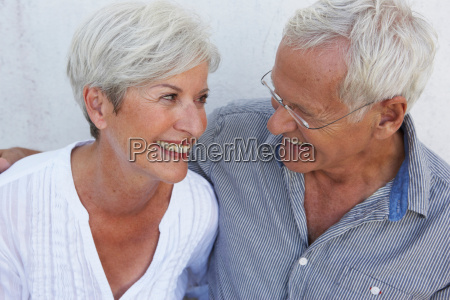 senior couple smiling to each other