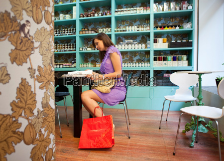 young woman sitting in cafE store