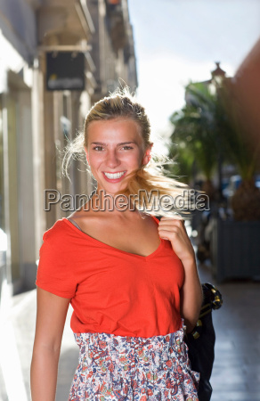 portrait happy woman in street with