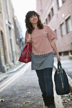 young female walking in street with