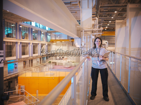 female scientist holding clipboard in particle