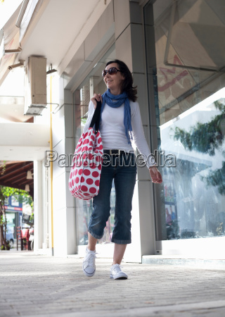 woman walking down urban street