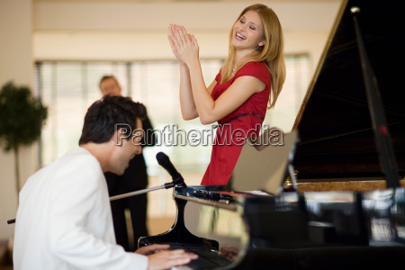 piano player and singing girl