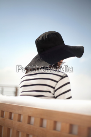rear view of woman in sun