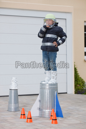 boy standing on self constructed rocket