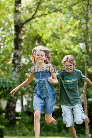boy chasing girl in garden
