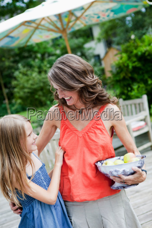 mother and daughter with bowl of