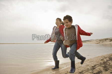 mother and son running together on