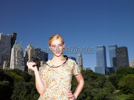 woman taking pictures in central park