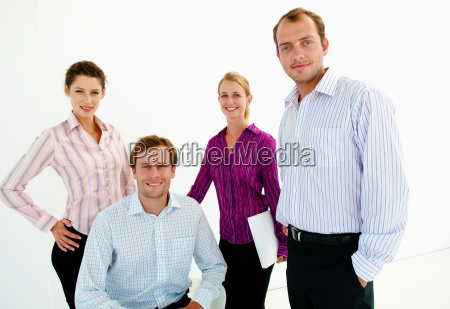 team of four confident business people