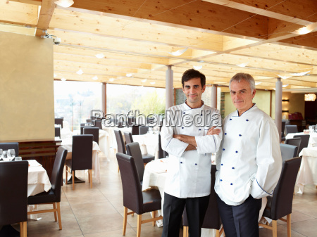 two proud chefs in a large