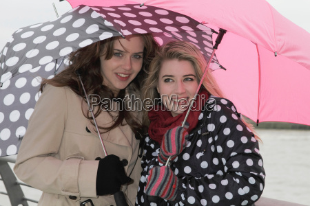 2 young women with umbrellas