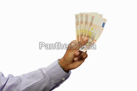 businessman holding euro notes