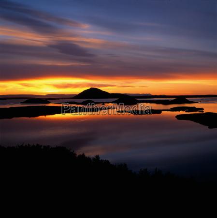 sunset reflected in still lake