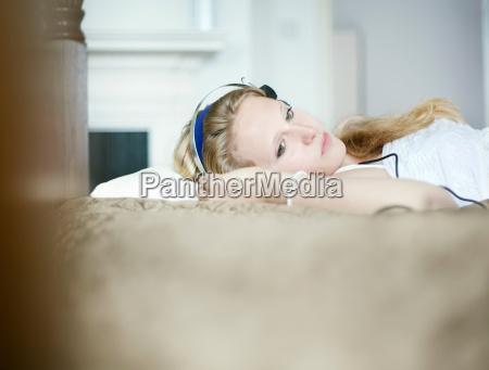 teenage girl listening to headphones