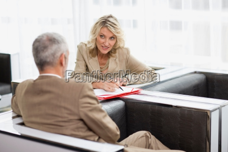 business people talking in lobby area