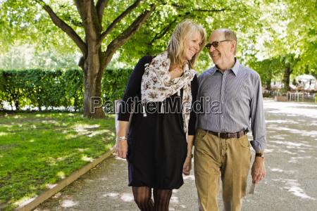 older couple walking hand in hand