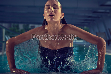 woman, rising, from, swimming, pool - 18283770