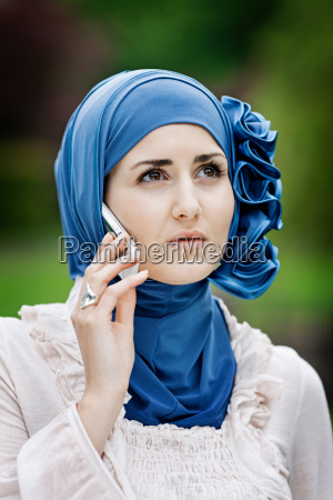 woman in headscarf talking on cell