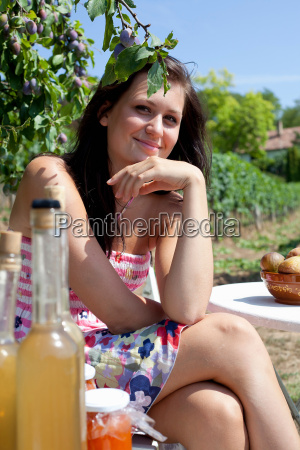 smiling woman picnicking outdoors
