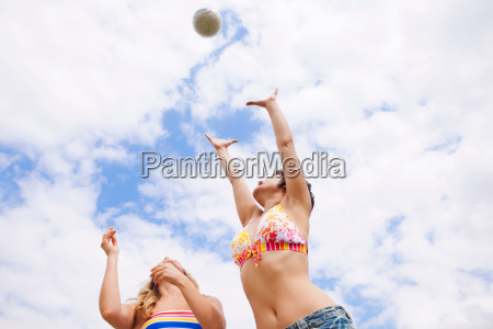 women playing with ball outdoors
