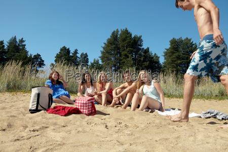 friends having picnic on beach