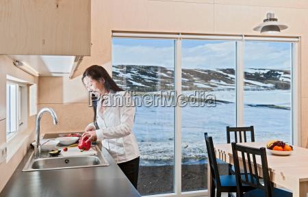 woman preparing food in chalet kitchen