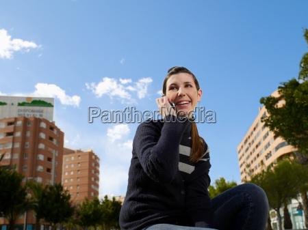 teenage female on mobile phone