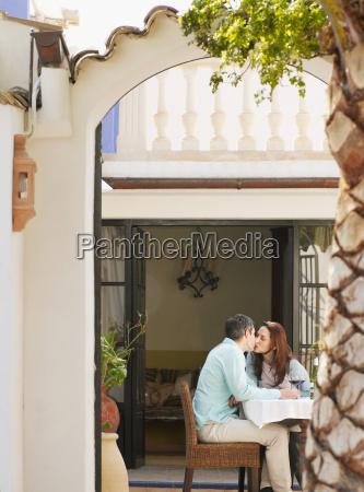 couple, sitting, on, garden, terrace - 18288976