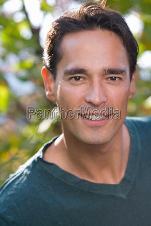 man smiling outdoors looking at camera
