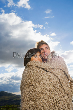 man and woman wrapped in blanket