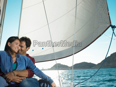 young, couple, relaxing, on, yacht, smiling - 18289090