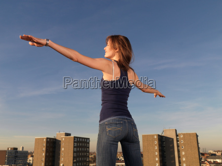 woman standing arms outstretched
