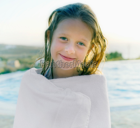 young girl wrapped in towel by