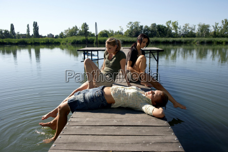 three young women on a pier