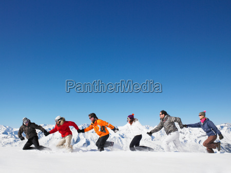 group running in snow