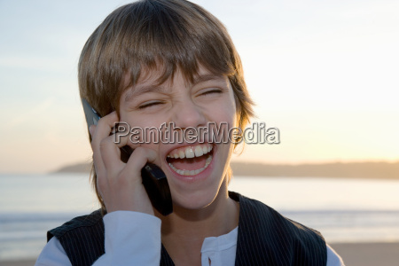 young boy on cell phone