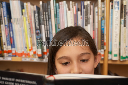 girl reading a book close up