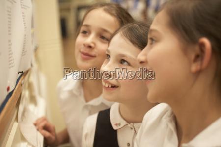 girls reading message board