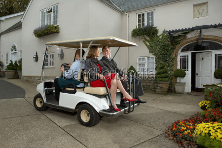 man driving cart with man and