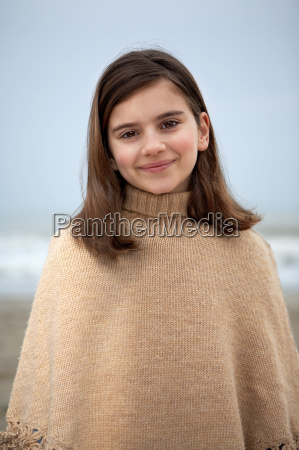 girl on beach smiling portrait