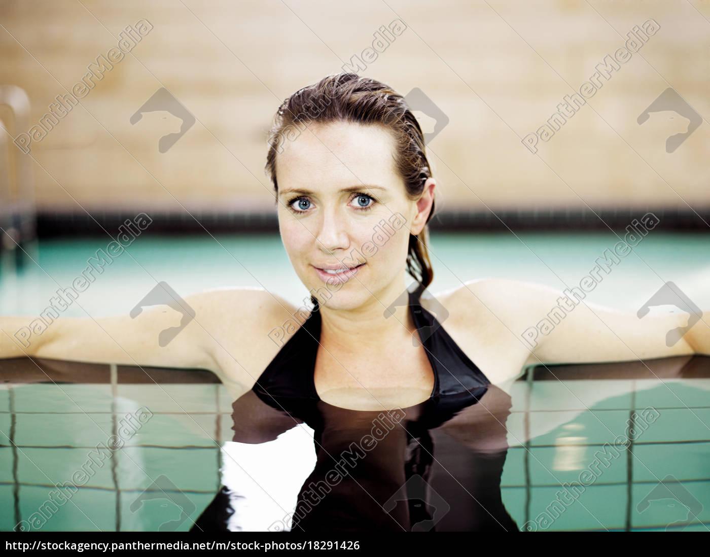 woman, in, swimming, pool, smiling - 18291426