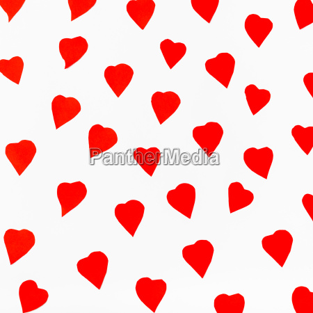 red hearts carved from paper on
