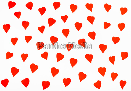 many red hearts cut out from