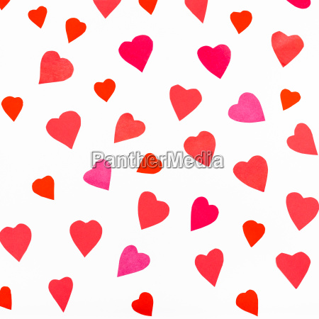 pink and red hearts cutout from
