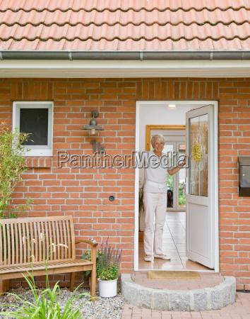 woman in the doorway of a