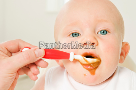 a portrait of a baby eating