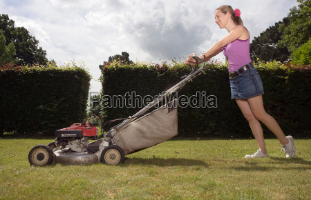 women with push lawnmower